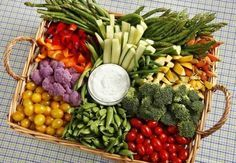 Veggie trays can get heavy, but organizing them in a basket like this one makes it easy to carry around.
