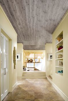 Giving your Old Ceiling a Makeover with Armstrong Ceilings. Revamp your damaged ceiling with gorgeous architectural ceiling planks, tin and drop-in tiles. #DIY #interiors #ceiling