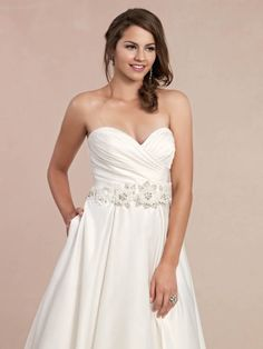 Style GA2227 / Gallery Collection / by Ella Rosa / Available Colours : Ivory, White / Shown Waistband with Floral designs & side Pockets at skirt (close up)