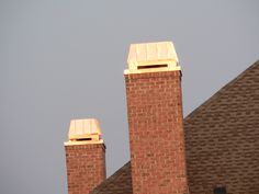 Tandem Majesty style chimney crowns in Perfect non-tarnishing copper with matching chase pans from Chimney King. UL listed and labeled too!