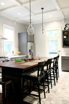 Love this kitchen island countertop and eating space.