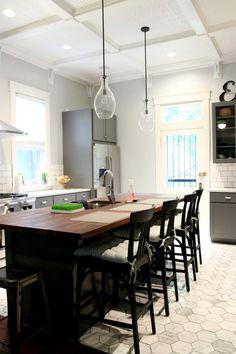 Gorgeous kitchen - gray cabinets, tile floor, subway tile, quartz countertop, butcher block countertop