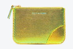 Is COMME des GARÇONS' collection of leather jewel wallets a bit flashy for you?