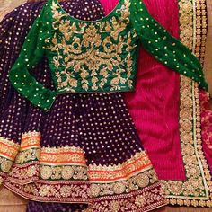 Beautiful Purple Pink and Bottle Green Mehndi Lehnga Choli To order email us at… Pakistani Mehndi Dress, Pakistani Fashion Party Wear, Pakistani Wedding Outfits, Pakistani Wedding Dresses, Pakistani Dress Design, Bridal Outfits, Indian Fashion, Pakistani Clothing, Mehendi