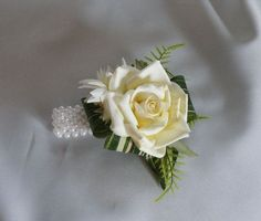 This attractive wrist corsage would be suitable for a wedding or prom. Description from etsy.com. I searched for this on bing.com/images