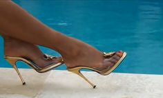 Mesmerizing feet | With clear heels at the pool.