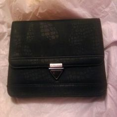 I just discovered this while shopping on Poshmark: Bcbg black clutch. Check it out!  Size: OS