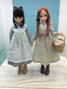Custom Ruruko dolls, Anne of Green Gables (the red braids) and her best friend Diana Barry (she has a B embroidered on her pinafore)