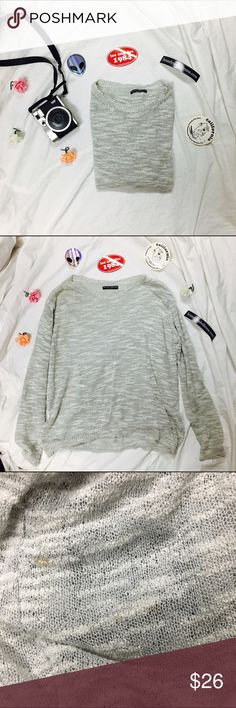 Light Grey Sweater Preowned Brandy Melville Light Grey Thin Sweater.   One Size (probably best fits a XS, Small or Medium)  A few orange stains throughout. I couldn't take pictures of all the stains so let me know if you want to see them!! One small snag towards the bottom of the sweater.   ❗️No trades!!!❗️ Brandy Melville Sweaters Crew & Scoop Necks