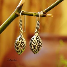A simple oxidised earring . Perfect for daily and casual wear .Goes well with all the outfits.