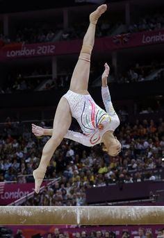 Chinese gymnast Deng Linlin performs on the balance beam during the artistic gymnastics women's apparatus finals at the 2012 Summer Olympics, Tuesday, Aug. 7, 2012, in London. (AP Photo/Julie Jacobson)