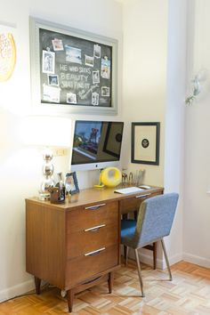 mid-century Kent-Coffey desk, wall-mounted iMac, inside of frame painted in chalkboard paint to write reminders, inspiration quotes and display photos. also love the chair!