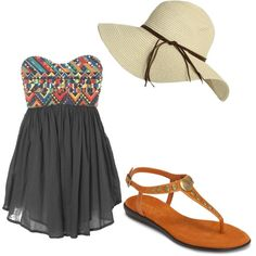 Floppy sun hat. Strappy brown sandals. Strapless dress, Tribal print on top and black on bottom.