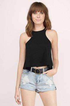 bbf61d4ee4f Basic crop top with a high neckline and no sleeves. In the back there is