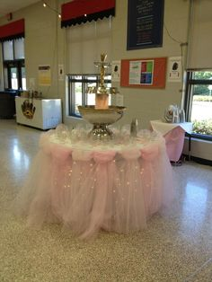 Tulle skirt with lights around the punch fountain table.