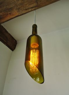 Wine Bottle Hanging Pendant Lamp gives a warm glow to your wine-sipping space. Just hang and plug into any outlet! Made by Conversation Glass on Etsy
