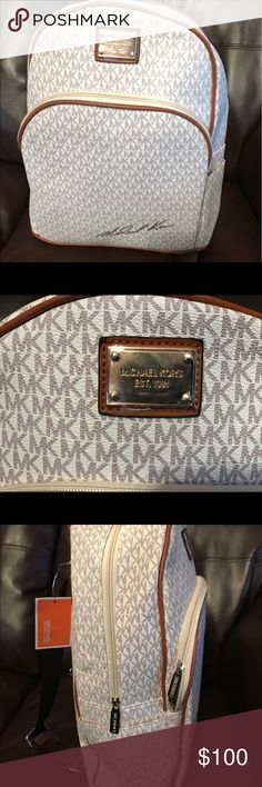 Michael Kors Book Bag Genuine leather Michael Kors book bag. Very rare! You're be sure to turn heads with this bag. Comes in white, brown, and white KORS Michael Kors Bags Backpacks