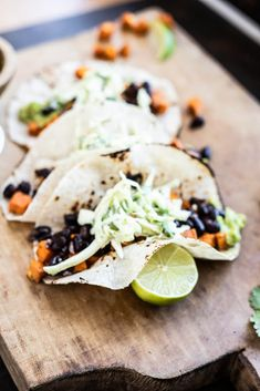 Roasted sweet potatoes, black beans, mashed avocado,   a cilantro ranch slaw all wrapped in your favorite charred tortilla = the BEST taco night EVER. Gluten free with a vegan option. #tacos #sweetpotatoes #blackbeans #veganrecipes #vegetarianrecipes #glutenfreetacos #savorylotus