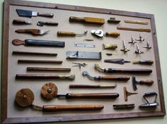 Various bookbinding tools, on display in Acme's conference room. This was apparently made as a gift for Paul's father from tools he actually worked with.
