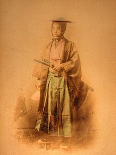Samurai, a tinted albumen print from a Japanese photo album of the 19th century.