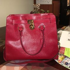 Michael Kors The Perfect Red  Leather Hamilton Perfect condition purse, only used 5 times. Stayed covered in its original dust cover bad. ❤️             Reasonable offers only!!! Michael Kors Bags Shoulder Bags