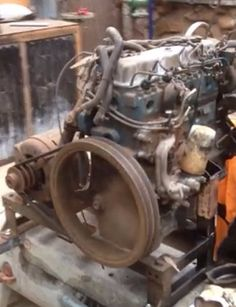 Air Compressor by jdownunder -- Homemade air compressor constructed from a diesel engine driven by an electric motor. http://www.homemadetools.net/homemade-air-compressor-19