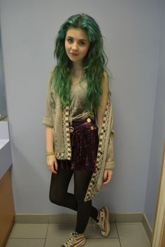 Green/yellowish hair.