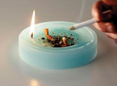 candle ashtray. the butts and ashes sink into the melted wax, lessening the odor of the cigarettes.