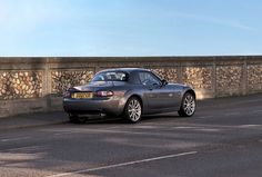 Mazda MX5 mk3 by Brett Oliver, via Flickr  Metallic grey MX5 Coupe Roadster - boy, this guy knows how to work a camera!
