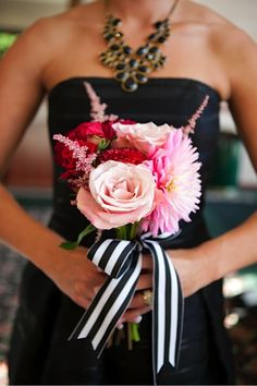 I really like the black (or is it blue??!) dress color with the black/white striped ribbon with the pretty flowers. I think I should have had a career in design. hehe