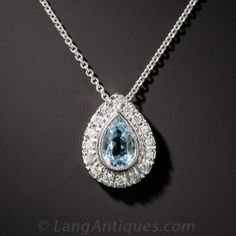 Newly made in traditional classic style, a bright sky blue aquamarine teardrop glistens within a sparkling white diamond frame. Petite - just shy of 1/2 by 3/8 inches. 16 inch chain.