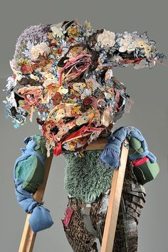 """ELISABETH HIGGINS O'CONNOR       Unless, 2011 Cardboard, wood, resin, acrylic, paint, bed sheets, bath rugs, blankets, cushion foam, duct tape, paper, drywall screws 94"""" x 60"""" x 41""""  click on an image to view larger"""