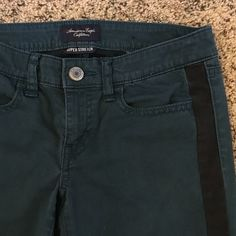 """American Eagle tuxedo jeggings Dark real super stretch jeggings from American Eagle. Black tuxedo stripe down the side of each leg. Size 4 short. Not denim...54% cotton/43% rayon/3% spandex. Very stretchy and comfy. I'm 5'5"""" and they hit at my ankle. American Eagle Outfitters Jeans Skinny"""