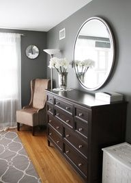 round mirror over long dresser (both Ethan Allen) paint: Benjamin Moores Amherst Grey, small mirror: Pottery Barn, Jill Rosenwald Fallon rug. Master bedroom or Office wall color.