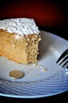 """Greece has a wonderful tradition of making a cake with a hidden coin and cutting it on New Year's. The person who has the coin in their piece has good luck for the year. """"Vasilopita"""" commemorates a miracle performed by St. Greek Sweets, Greek Desserts, Greek Recipes, Vasilopita Cake, Greek Cake, Greek Bread, Greek Christmas, Christmas Baking, Gourmet"""