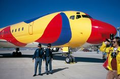 """Braniff International Douglas DC-8-62 N1805 is guarded by a pair of Texas Rangers at Dallas-Fort Worth, 29th October 1973. The occasion was the unveiling of the special """"Flying Colors of South America"""" livery, designed and painted by acclaimed artist Alexander Calder. (Photo: Courtesy of the Inge Morath Foundation, Copyright: Braniff Flying Colors Collection)"""