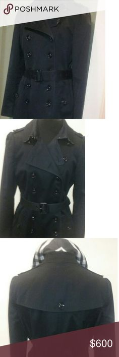 Burberry Trench Coat Burberry Double Breasted Trench Coat.  Slim fit and Long past the Knee. Fully lined. 39.5 in long. Gently worn. Burberry Jackets & Coats Trench Coats