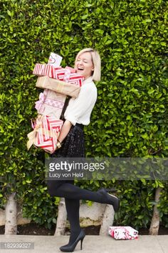 Stock-Foto : Caucasian woman carrying Christmas gifts