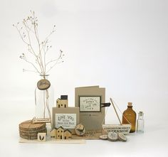 East of India wooden gifts. Kraft cards and boxes, little boats and wooden houses