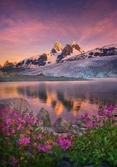 """How beautiful on the mountains are the feet of the messenger who brings good news, the good news of peace and salvation, the news that the God of Israel reigns!"" Isaiah 52:7    (PHOTO credit: ""Glacier Peaks"" by Marc Adamus). Beautiful glacier peaks, color-rich painted skies, flowers and crystal lake credit - and credit for ALL creation: GOD ALMIGHTY!"