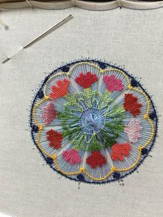 circle weaving with flower embroidery