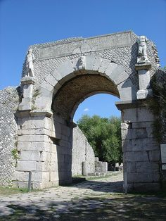 Altilia-Saepinum, the Bojano Gate -- Saepinum is a Roman town in Molise region which was abandoned at the beginning of Middle Ages (ca. 6th c. CE) and then almost forgotten until the archaeological diggings in 1950. So Saepinum is a tiny, less known Pompeii, even if it's more similar to Volubilis (Morocco) or Bosra (Syria)