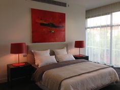 Bedroom styled by Lisa Gole, painting by Kirsten Jackson, lamps available from Space (Melbourne).