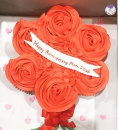 The best seller :) #cupcakes #cupcakebouquet #happyanniversary #redroses #rosettes #redribbon #hearts #pinkhearts #bouquet #atyummy #anniversarycake #customised