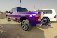 Purple lifted Chevy truck