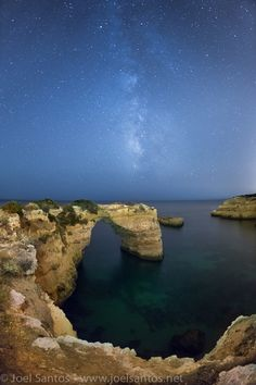 Milky way over the stone arch at Albandeira Beach, Portugal. #surfinportugal #algarve