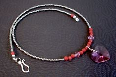 see om inspirations jewelry on FB. necklace, approximately 17 1/2 inches long, glass heart pendant, pink swarovski crystal, red faceted glass beads, grey metallic glass beads, sterling silver wire, sterling silver hook clasp, $25 includes shipping within the U.S. Feel free to send questions to me via facebook email. To order, send payment via paypal: yoginidb@yogafromthegroundup.com