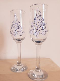 Christmas tree champagne glasses from Yereqnuk Handicrafts...they can do any theme you like on this or other glasses.