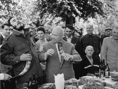 Khrushchev and Castro have lunch at a kolkhoz in Georgia, 1963.    Over 38 days, Cuba's Fidel Castro travelled all over the USSR – the only state leader to do so. It was widely publicised in the Soviet press, and this image of the two enjoying lunch was taken by Vasily Egorov  Photograph: Vasily Egorov/Lumiere Brothers Center for Photography