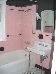 gray walls to tone down pink tile @Carley Powell Burch. This is EXACTLY like your bathroom with the tile in the shower floor! SO cute with the gray!